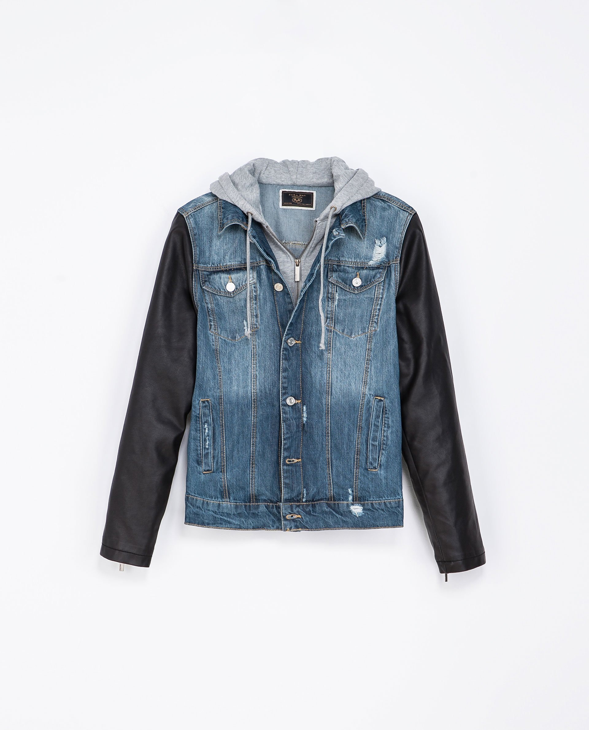 A combo of vintage leather and well-worn denim meets up to build the Leather Sleeve Slim Fit Denim Jacket. For the most authentic, well-worn look, the leather is washed and waxed while the denim is overdyed and stonewashed.