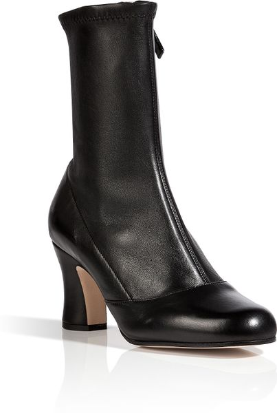 marc stretch leather ankle boots in black in black