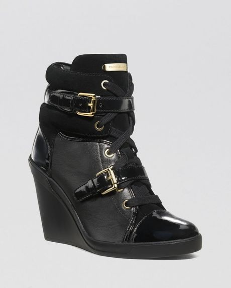 michael michael kors lace up high top wedge sneakers skid in black lyst. Black Bedroom Furniture Sets. Home Design Ideas