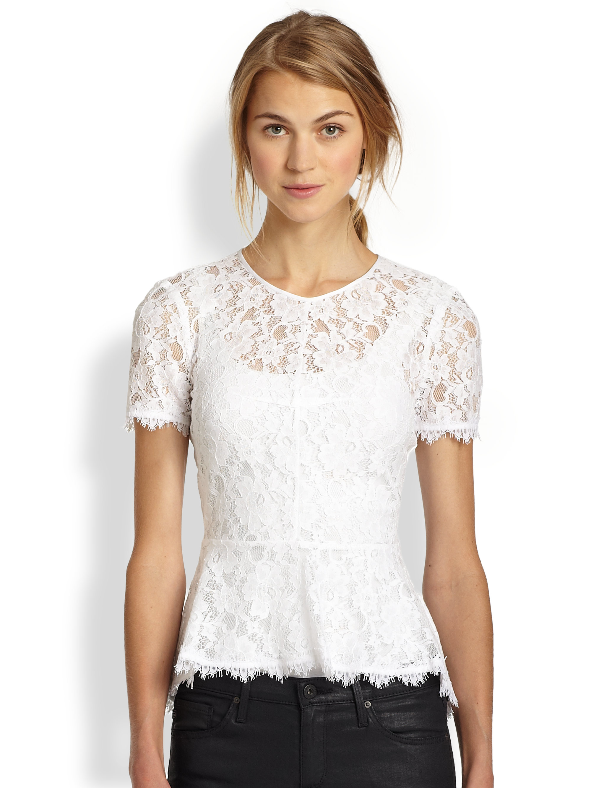 Darling eyelet lace is formed to this sleeveless halter top with a princess-seamed bodice, scalloped, crocheted lace accents, and peplum hem. Back keyhole with top button. Hidden side zipper/clasp/5().