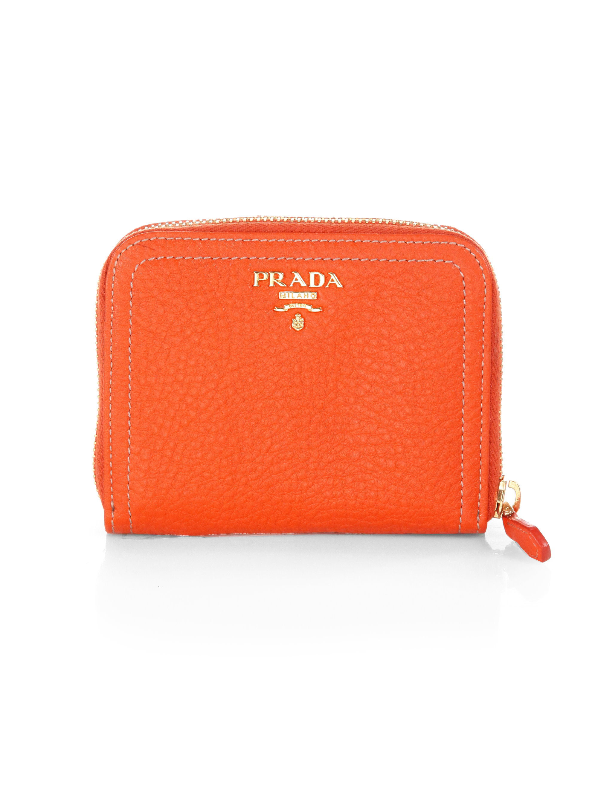 61874b6606 ... wholesale lyst prada daino small zip around leather wallet in orange  4a0e1 e0313