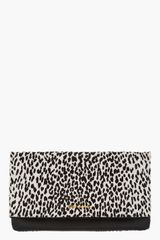 Saint Laurent Black Spotted Calf_hair Letters Clutch - Lyst