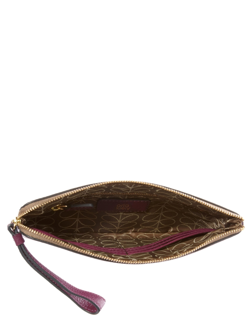 Lyst Orla Kiely Punched Leather Flat Zip Clutch Bag In Red Black Gallery