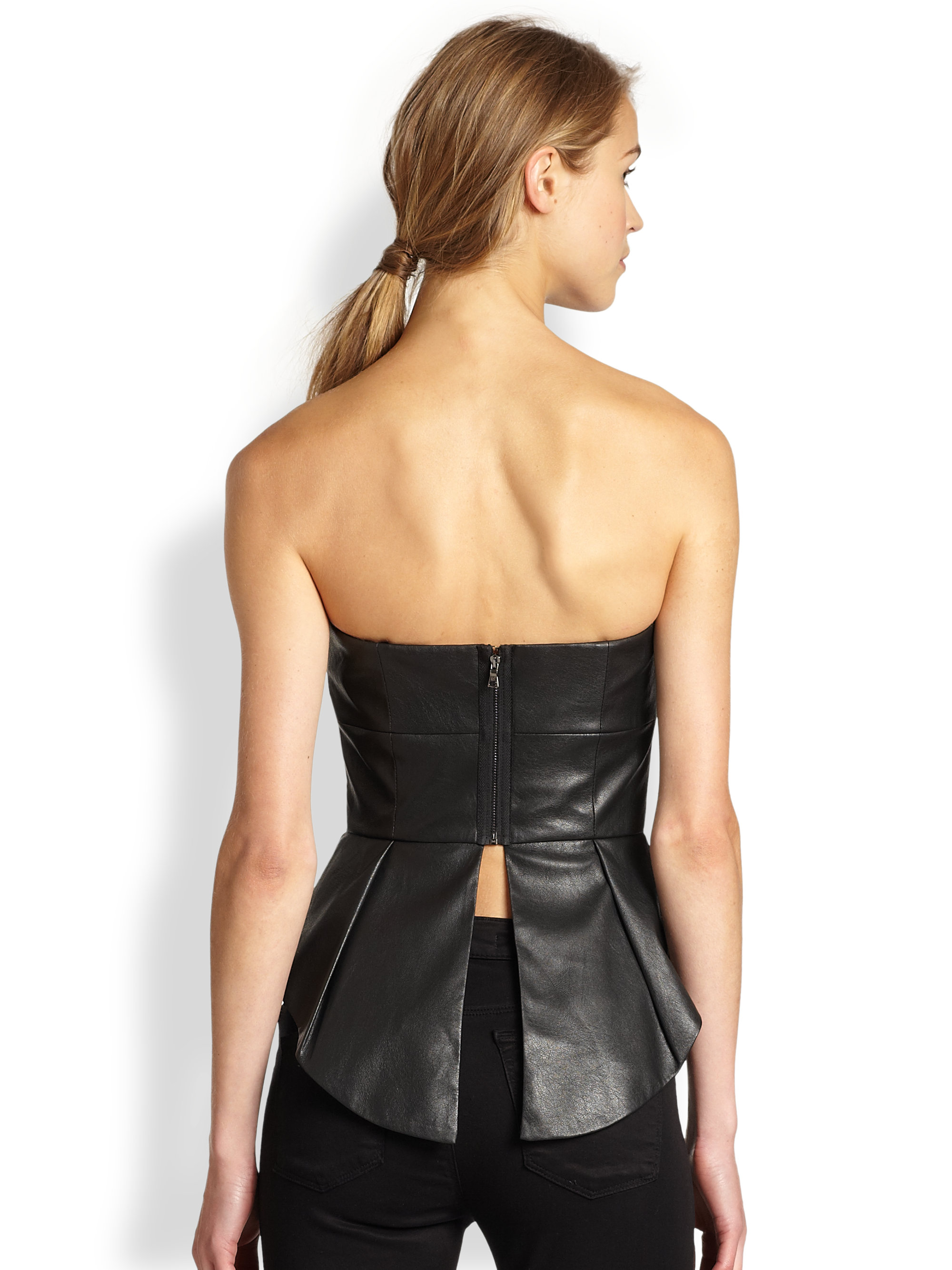 13c748d7f28 BCBGMAXAZRIA Faux Leather Peplum Bustier Top in Black - Lyst