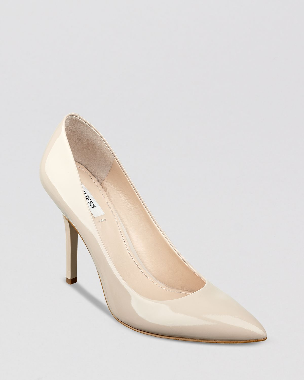 guess pointed toe pumps plasma high heel in white ivory lyst. Black Bedroom Furniture Sets. Home Design Ideas