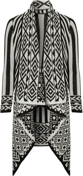 Serve up traditional black and white slayage with this Aztec print cardigan. It features an open front and flexible knit fabric%(16).