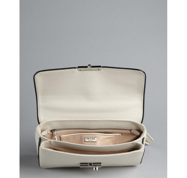 Prada Ivory Textured Leather Locking Convertible Handbag in White ...