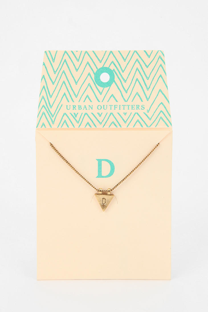 Urban outfitters Triangle Initial Gift Card Necklace in Metallic ...