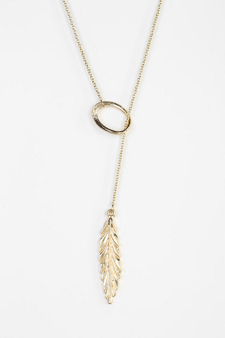 urban outfitters feather lariat necklace in metallic lyst. Black Bedroom Furniture Sets. Home Design Ideas