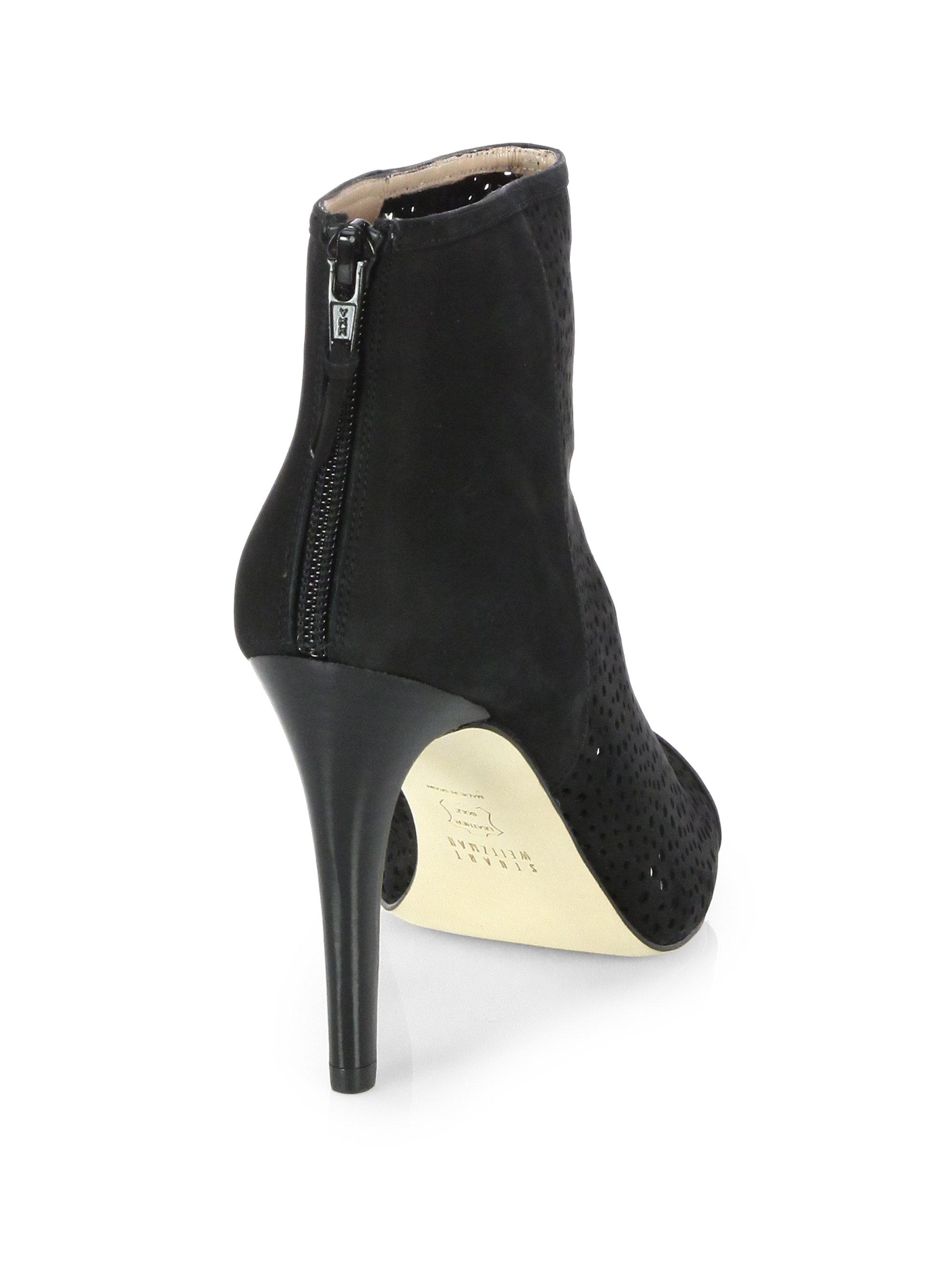 9b3983789eef Lyst - Stuart Weitzman Perforated Suede Peeptoe Ankle Boots in Black