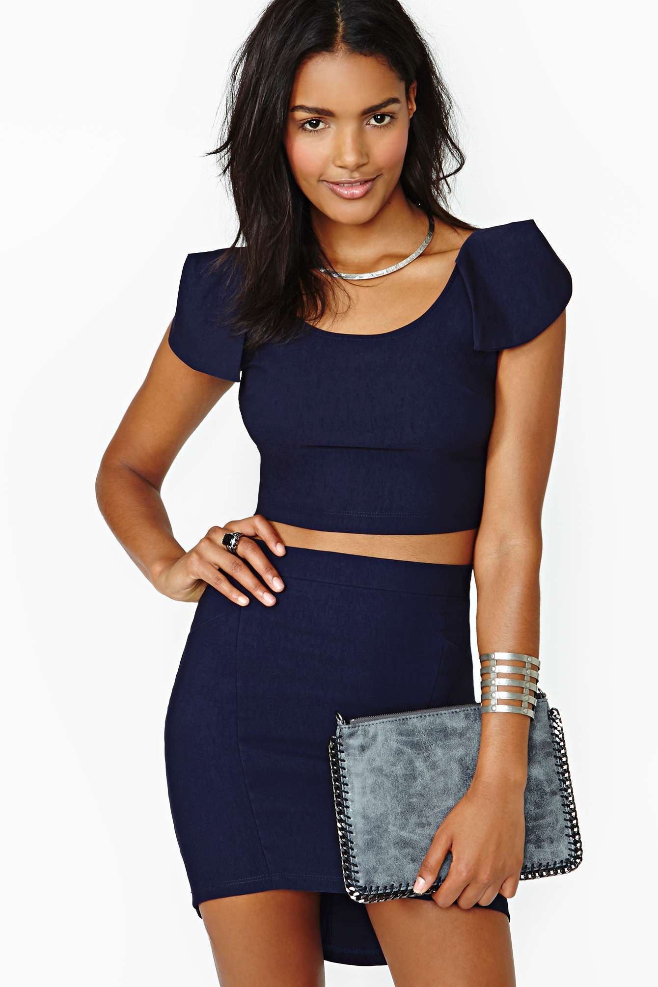 The Free People Solid Rib Navy Blue Cropped Tank Top loves to be styled simply or layered luxuriously! Super-stretchy, lightweight ribbed knit forms this essential tank top with a V-neck, wide straps, and a /5(62).