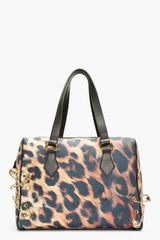 Versus  Gold and Black Leopard Print Safety Pin Duffle Bag - Lyst