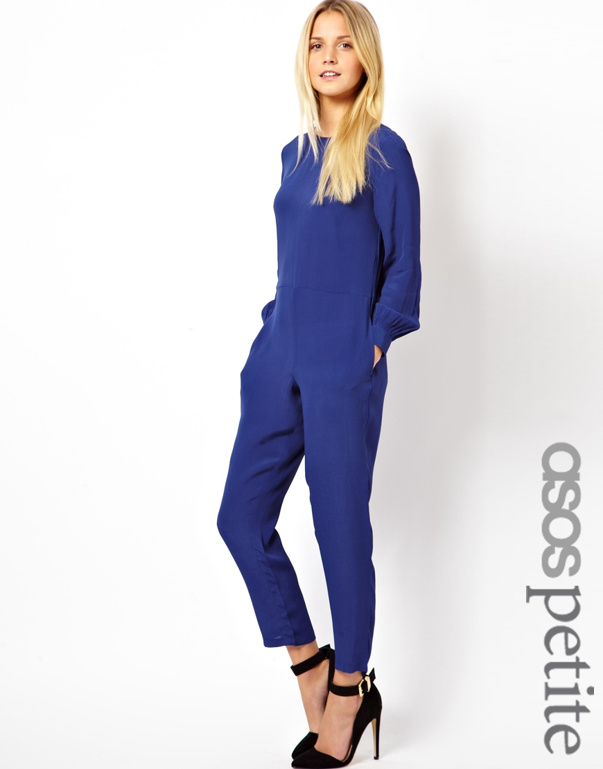 Create a stunning look for your next event in the C/MEO Eminence Navy Blue Long Sleeve Wide-leg Jumpsuit! Lightweight, textured woven poly shapes a plunging surplice bodice, and fitted long sleeves.