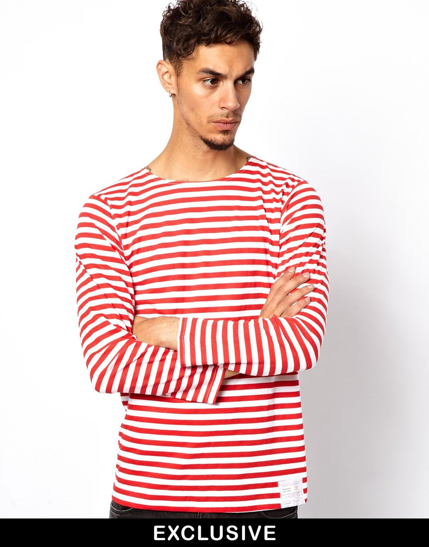 Ladies's elbow sleeve Breton top with white and red stripes from French label Armor Lux. Made from soft jersey combed cotton, heavy weight quality, turned back cuffs, round neckline, with a signature embroidered on left sleeve.
