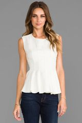 Halston Heritage Rounded Neck Peplum Top in Cream - Lyst