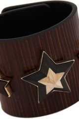 Givenchy Leather Wood Large Star Cuff - Lyst