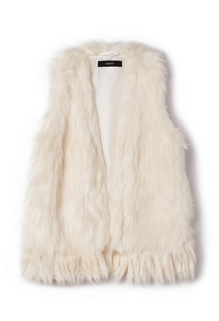 We made this vest in plush faux fur that just so happens to be the perfect layering piece. Not to mention, it's lined in satin with a ruffled edge that peeks out when worn open so it makes for an unforgettable holiday-party entrance. Faux-fur vest Semi-fitted Hook-and-eyes closure On-seam pockets Polyester/viscose/elastane. Machine wash warm.