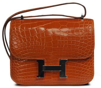 Hermes 18cm Orange Shiny Crocodile Mini Constance with Palladium - Lyst