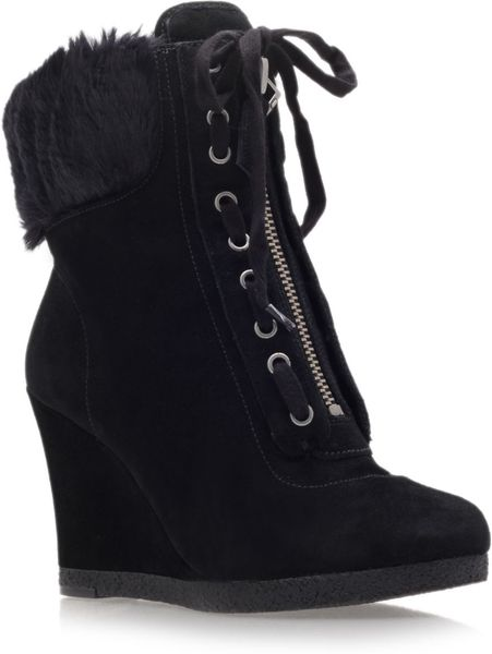 nine west bayla high heel wedge ankle boots in black lyst
