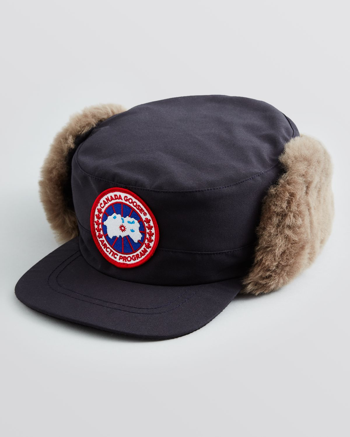 dc143fd2682 Lyst Canada Goose Clique Shearling Hat In Blue For Men