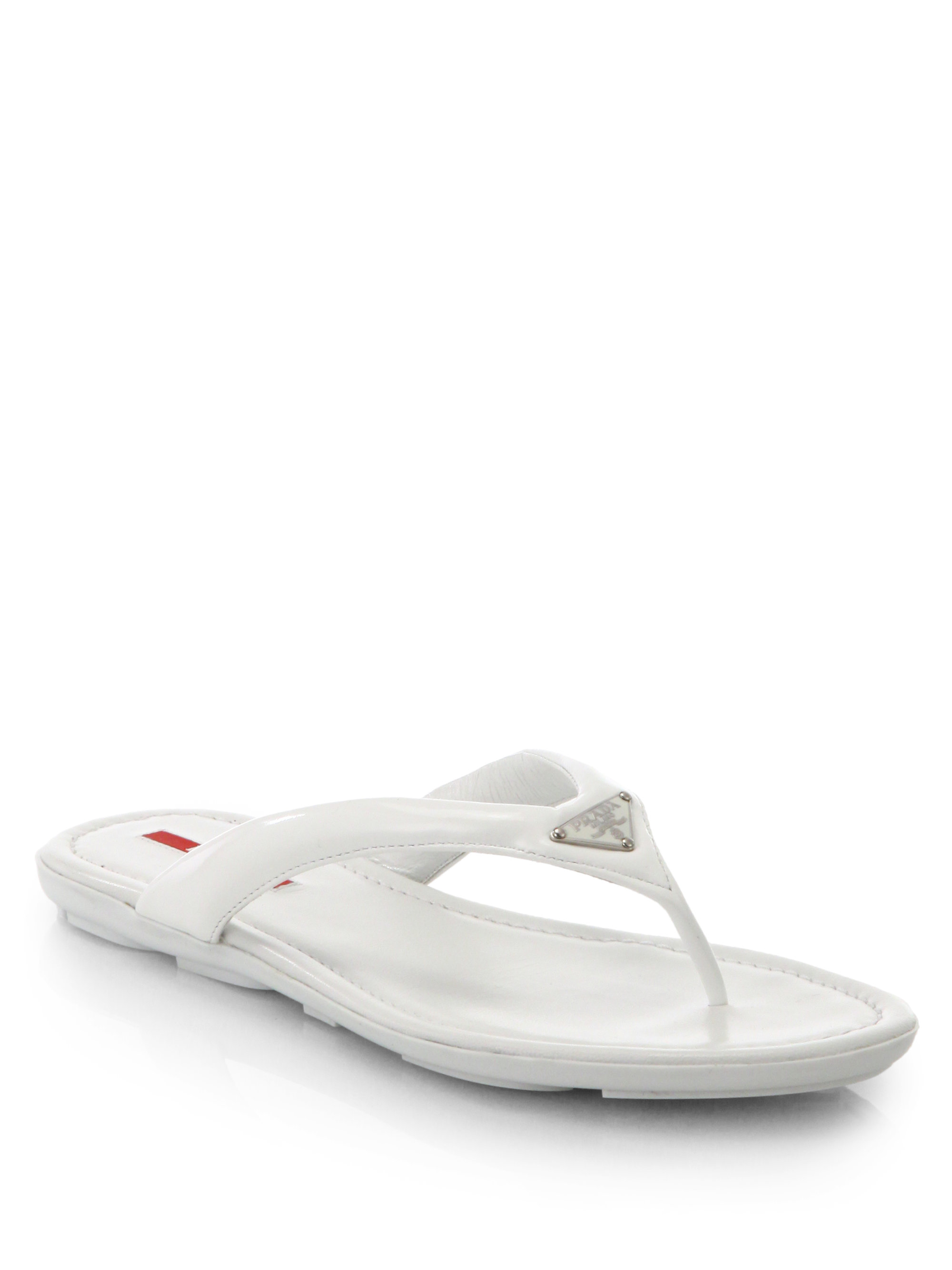 04a750b989c0 Prada Patent Leather Thong Sandals in White - Lyst