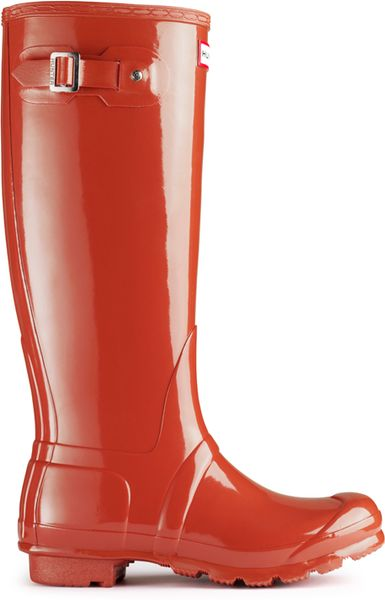 hunter original tall gloss rain boot in orange brick lyst