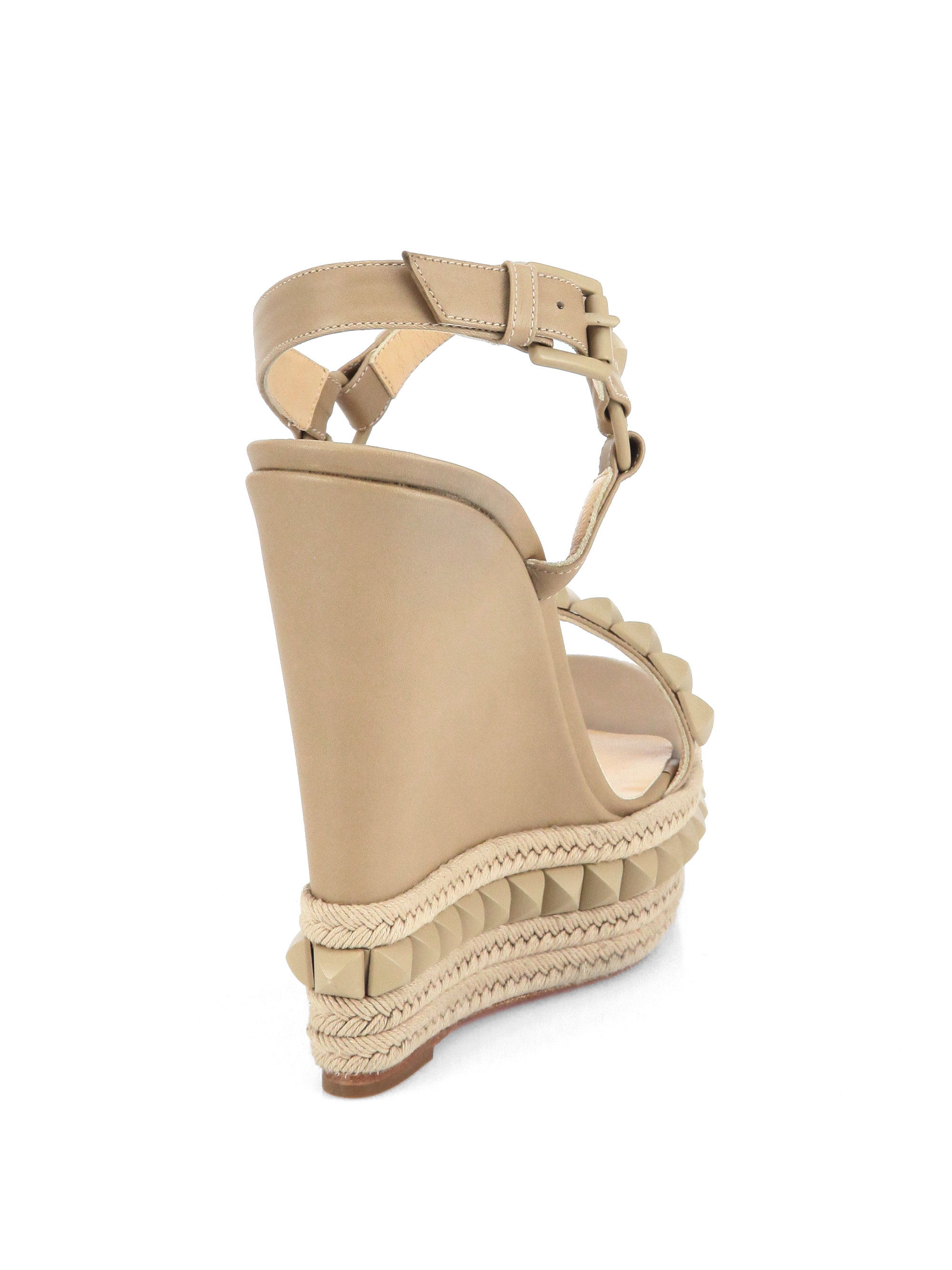 640493c79664 christian-louboutin-beige-cataclou-studded-leather-wedge-sandals-