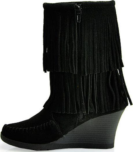 minnetonka suede fringe wedge boot in black lyst