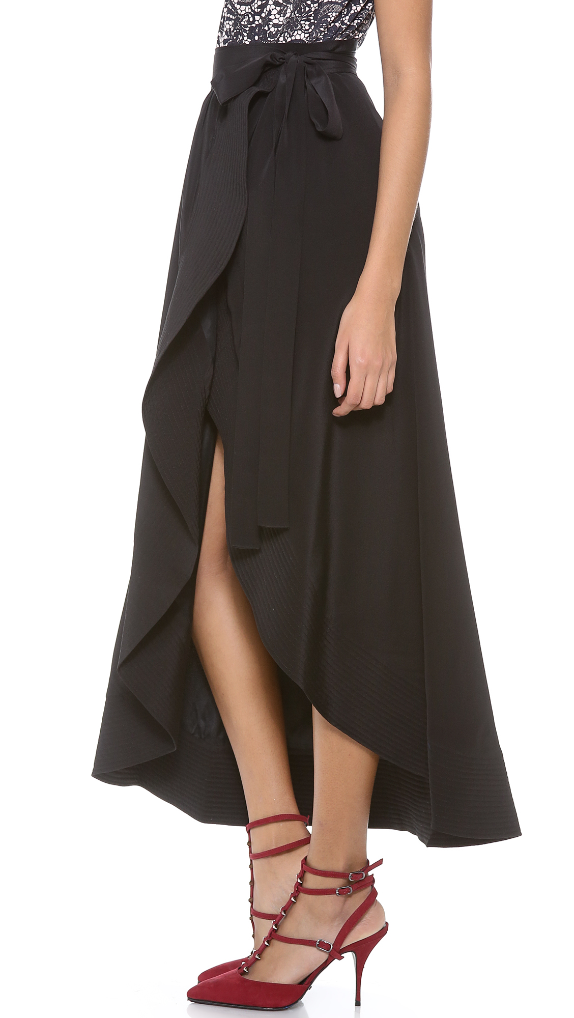 Ponte wrap skirt - Three gathers into waist - Exposed metal zip at back - Mid length Model is 5'7