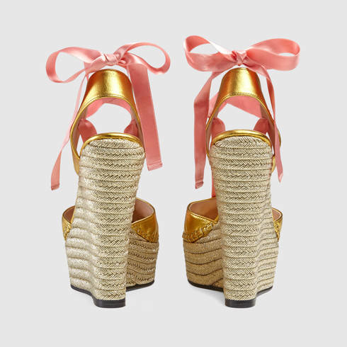 49397a2909cd Lyst - Gucci Metallic Leather Wrap Wedge in Pink