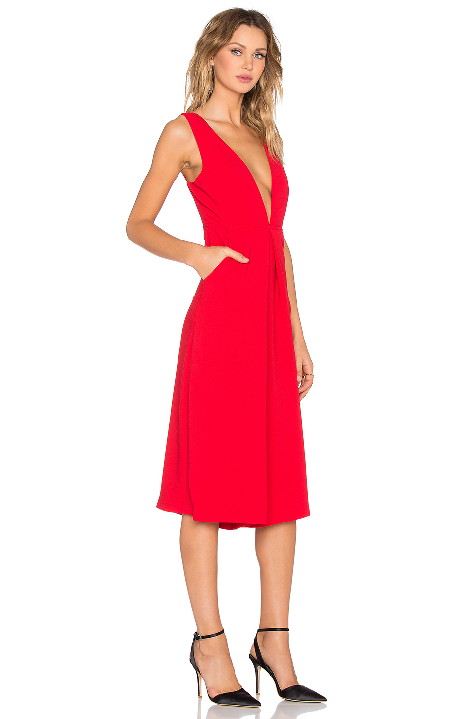 dc1a882c99b Lyst - BCBGeneration Deep V Gaucho Jumpsuit in Red