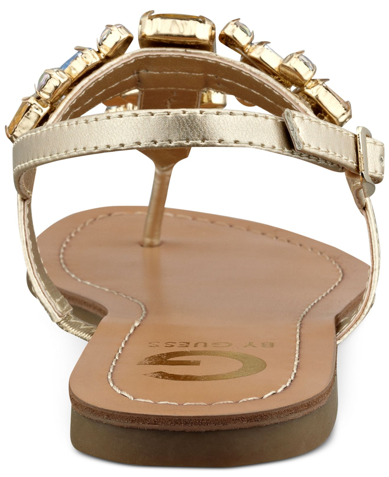 abc890ab7ac3a Lyst - G by Guess Women S Kyli T-Strap Flat Thong Sandals in Metallic