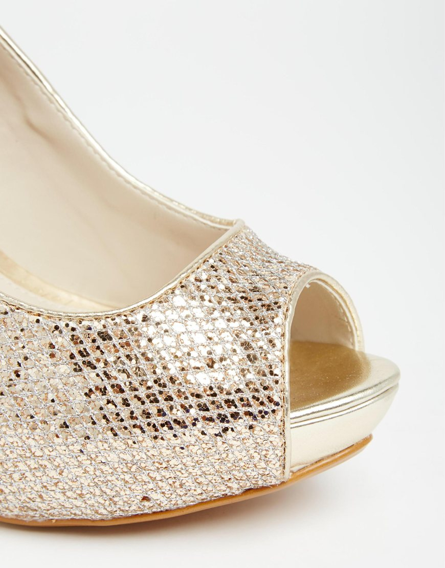 6c0dec4f89f Lyst - ALDO Nean Gold Glitter Peep Toe Heeled Shoes in Metallic