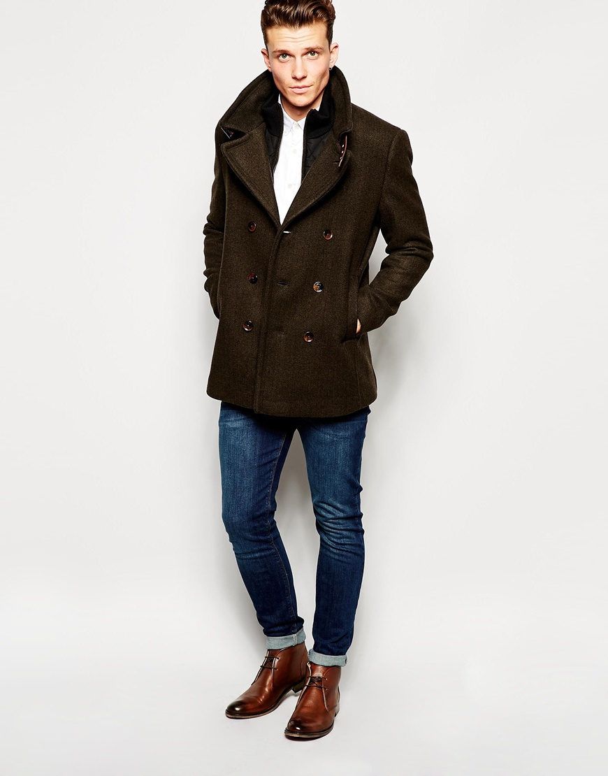 Men's Black Pea Coat, Grey Chinos, Black Leather Derby Shoes, Navy Leather Backpack If the above two options are still too dressy, then it's got to be a pair of suede shoes or boots in any colour except for a light brown.