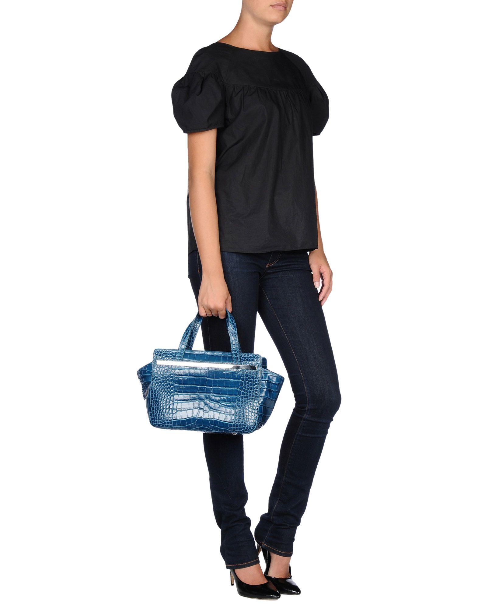 Lyst Nicoli Handbag In Blue