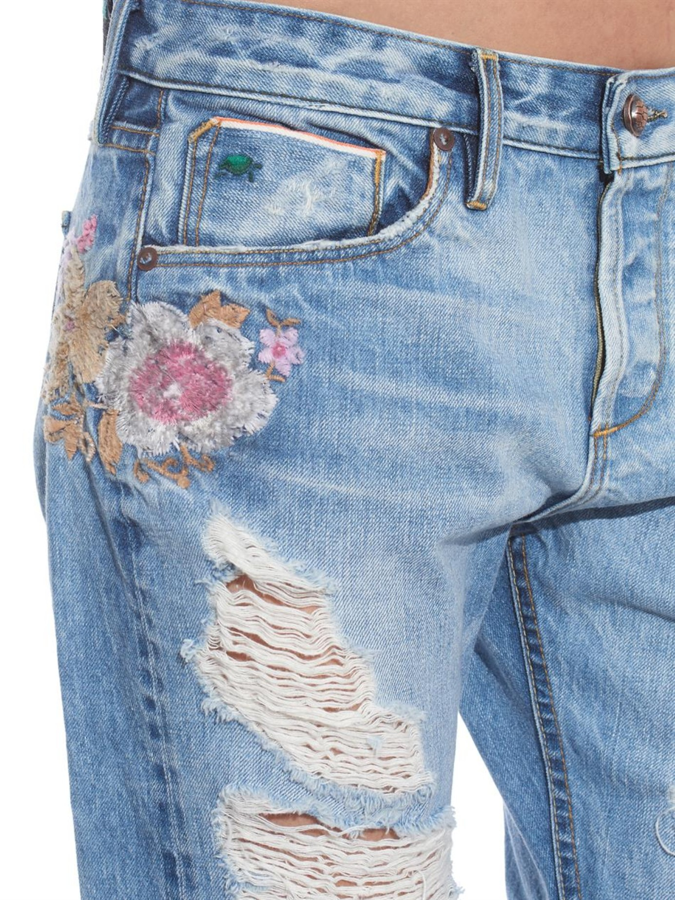 Tortoise savanna floral embroidered ripped jeans in blue