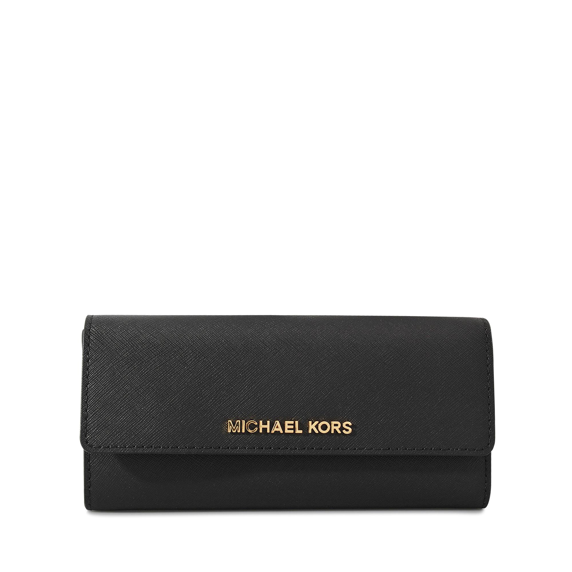 a0ca07f096f5 Michael Kors Jet Set Travel Lg Flap Carryall Wallet in Black - Lyst