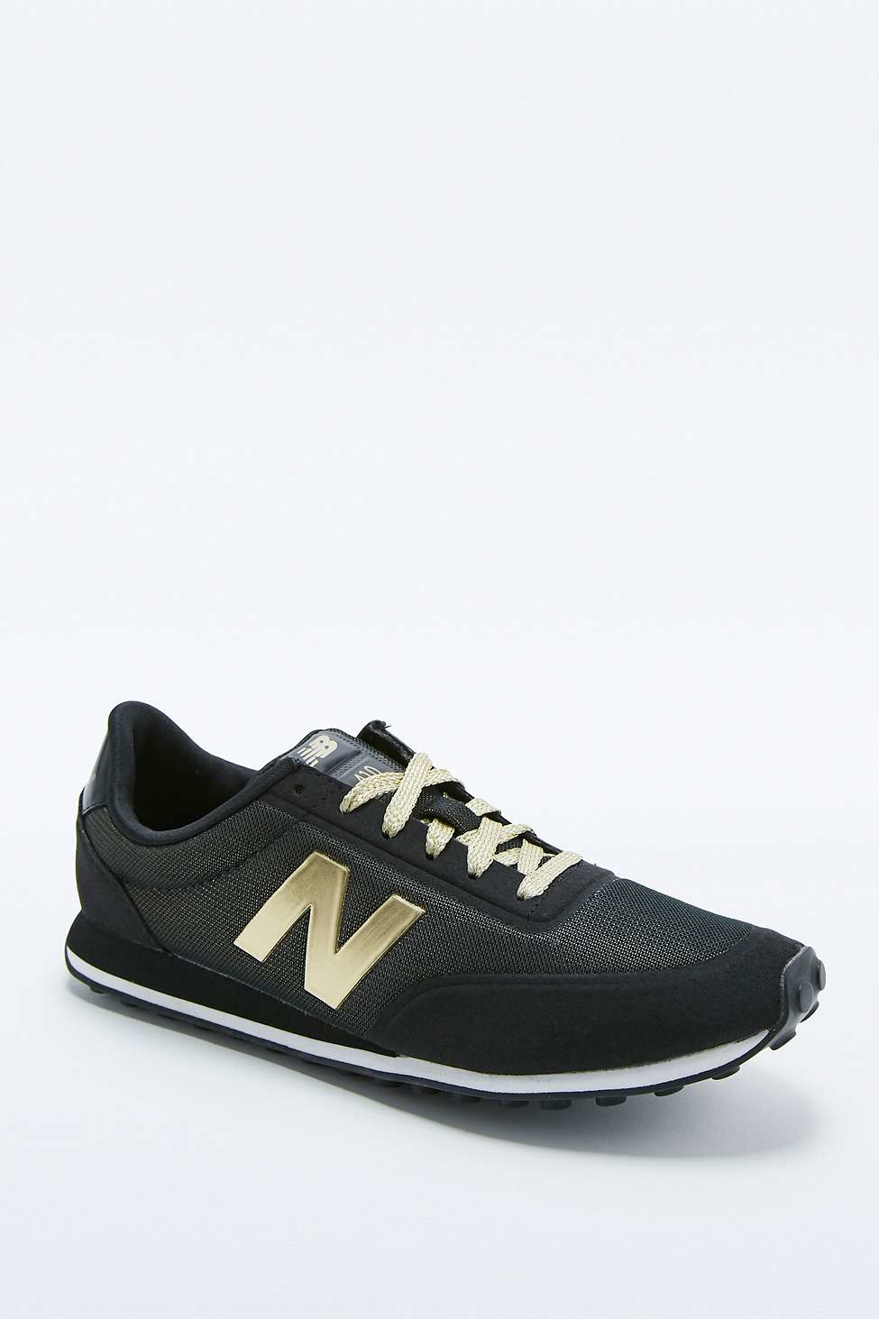 new balance 410 black and gold