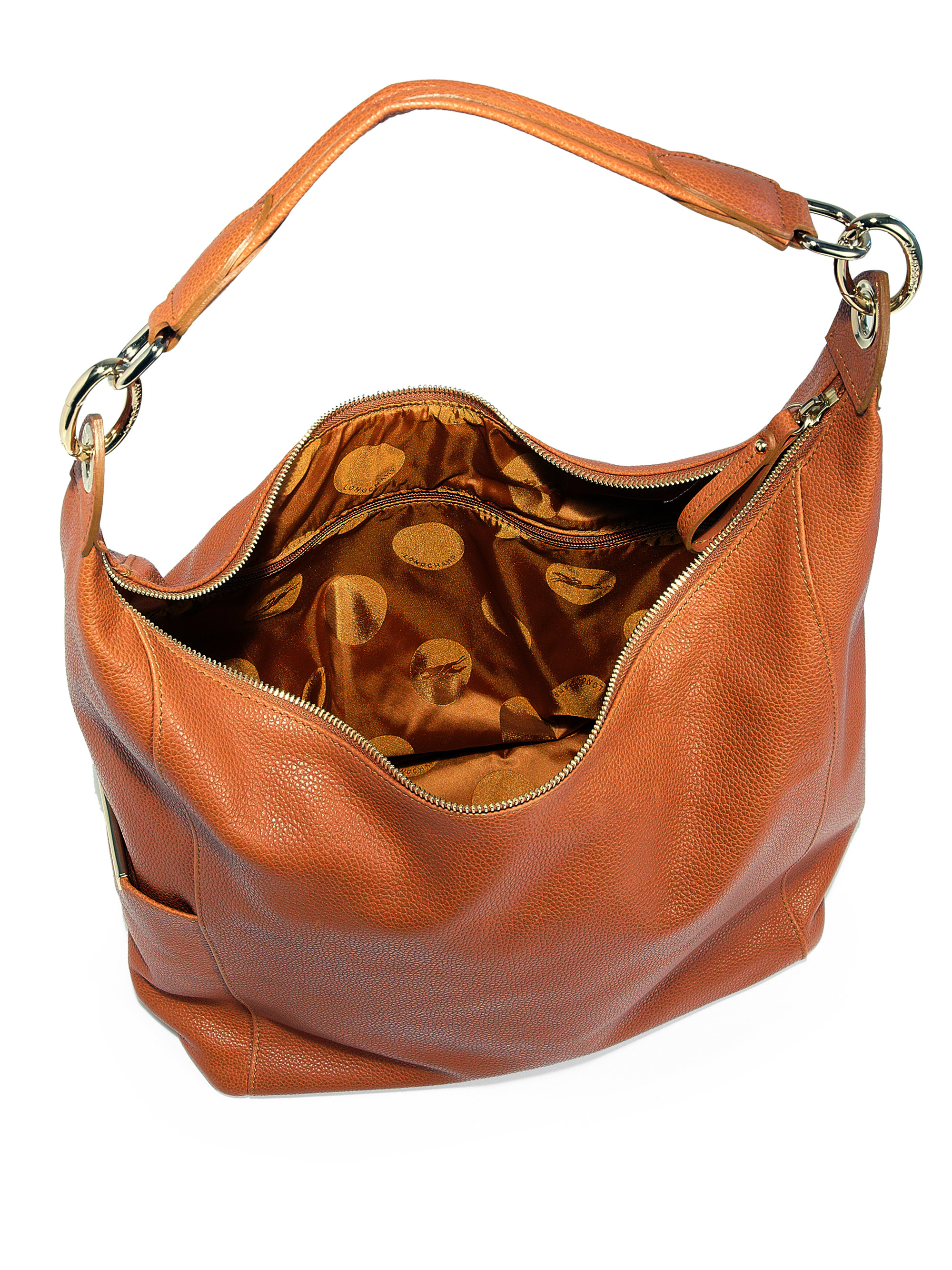 Shop women's leather bags and purses by Hobo. Our designer philosophy balances beauty and utility, artisan leather craft and flawless function. Hobo leather handbags and purses are eminently wearable and only get better with age.