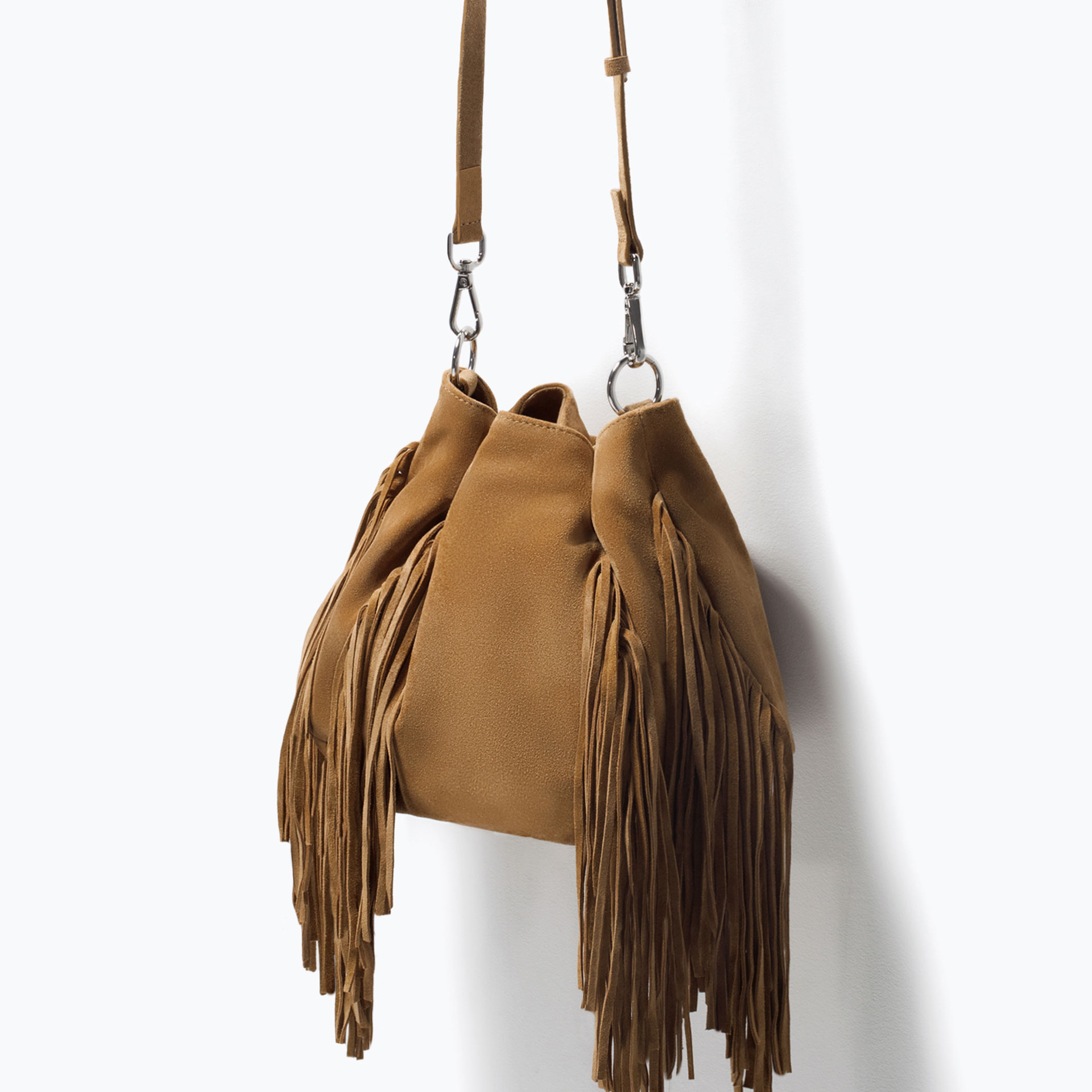 Beautiful Tory Burch brown suede fringe handbag! Only used once or twice and in perfect condition. When you open the flap, there is a pocket that is nearly the width of the bag.