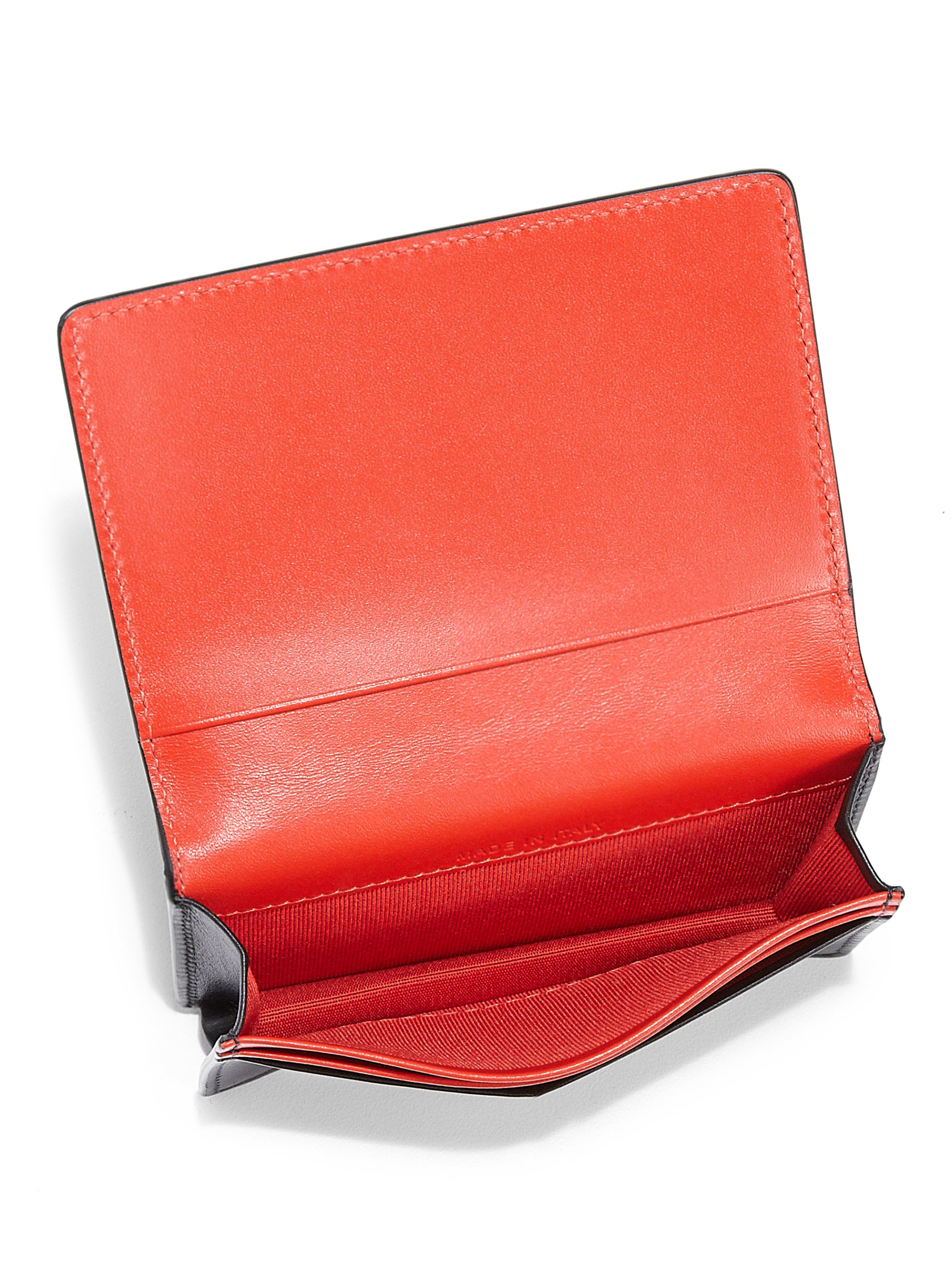 Christian louboutin Milos Spiked Leather Foldover Wallet in Black ... - prada wallet black + lacquer red