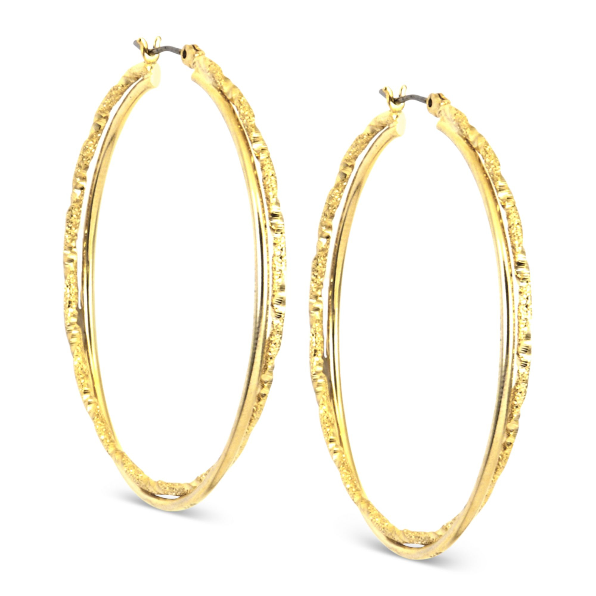 klein gold tone twist medium hoop earrings in gold lyst