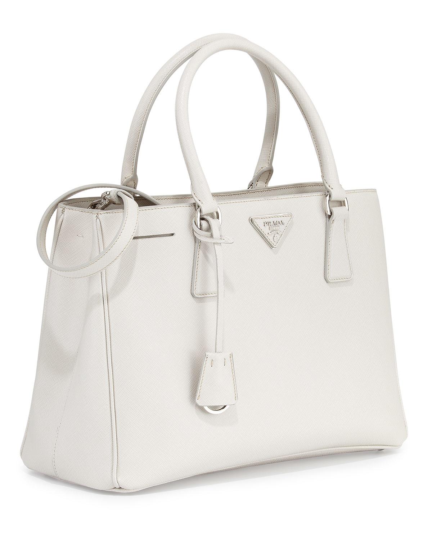 50b7ca4da74a ... germany lyst prada saffiano lux small gardeners tote bag in white 05274  9fa28