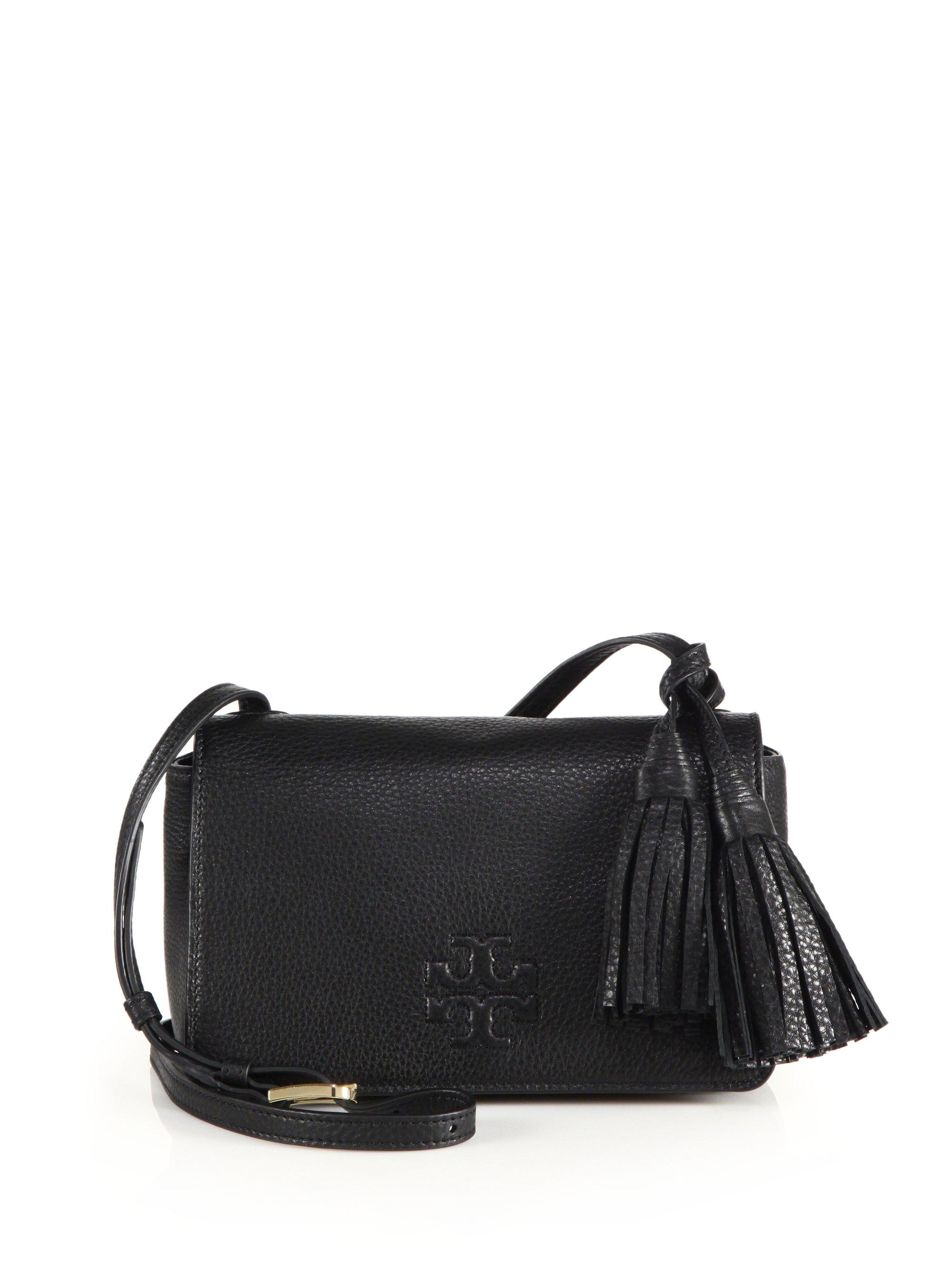 314d779d575a Lyst - Tory Burch Thea Mini Leather Tassel Crossbody Bag in Black