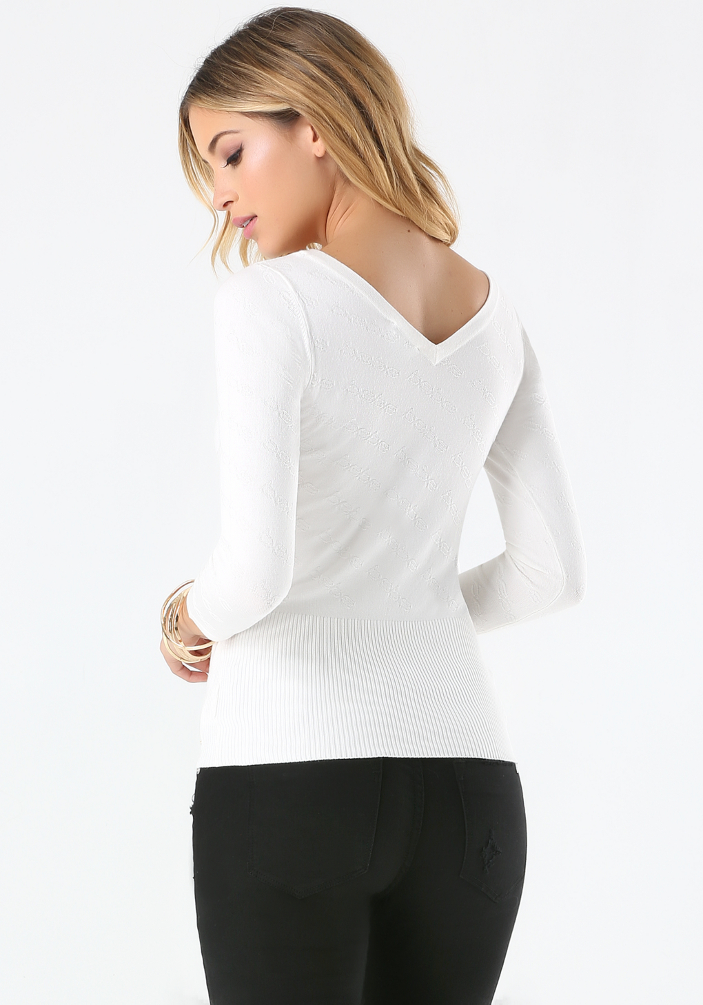 Bebe synthetic allover logo sweater in white lyst for Beb logo