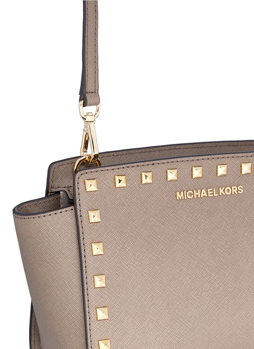 ff07d8bb94e4 Lyst - Michael Kors  selma Stud  Medium Saffiano Leather Messenger Bag in  Gray