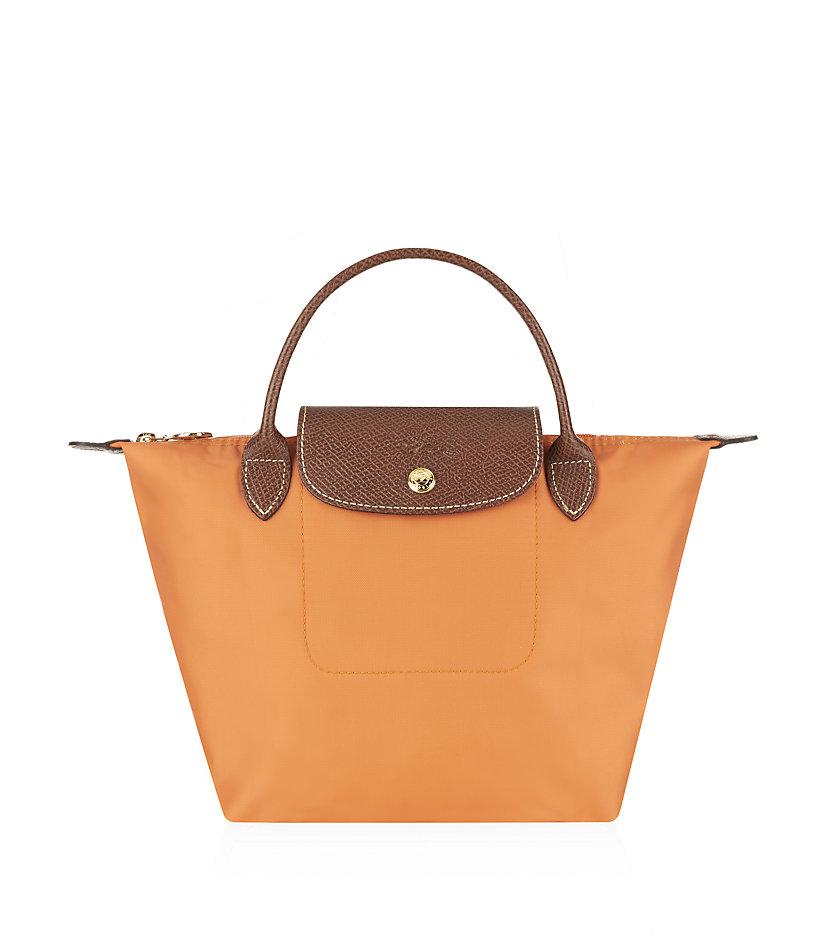 longchamp le pliage small handbag in orange lyst. Black Bedroom Furniture Sets. Home Design Ideas