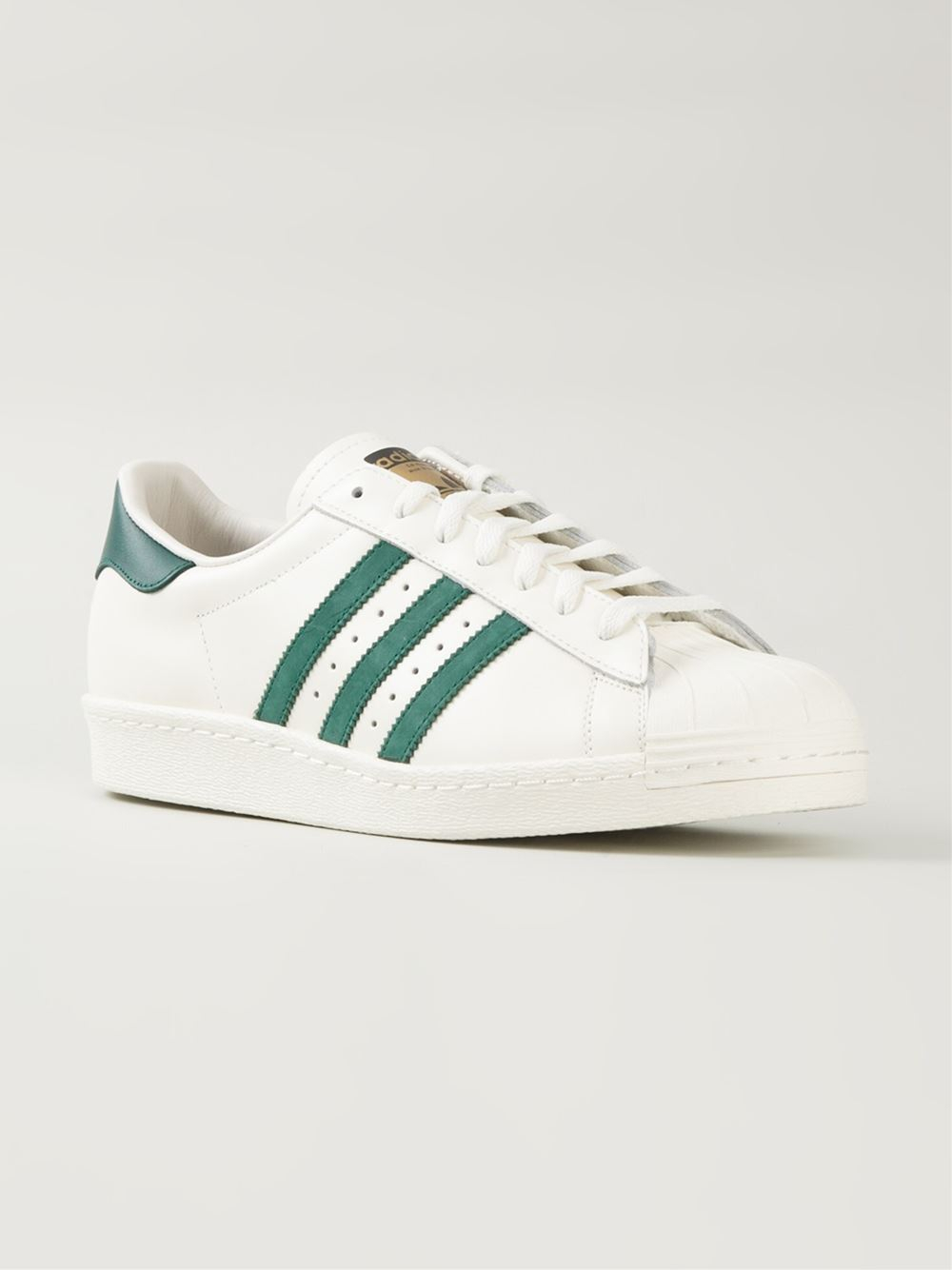 adidas originals superstar low top sneakers in white lyst