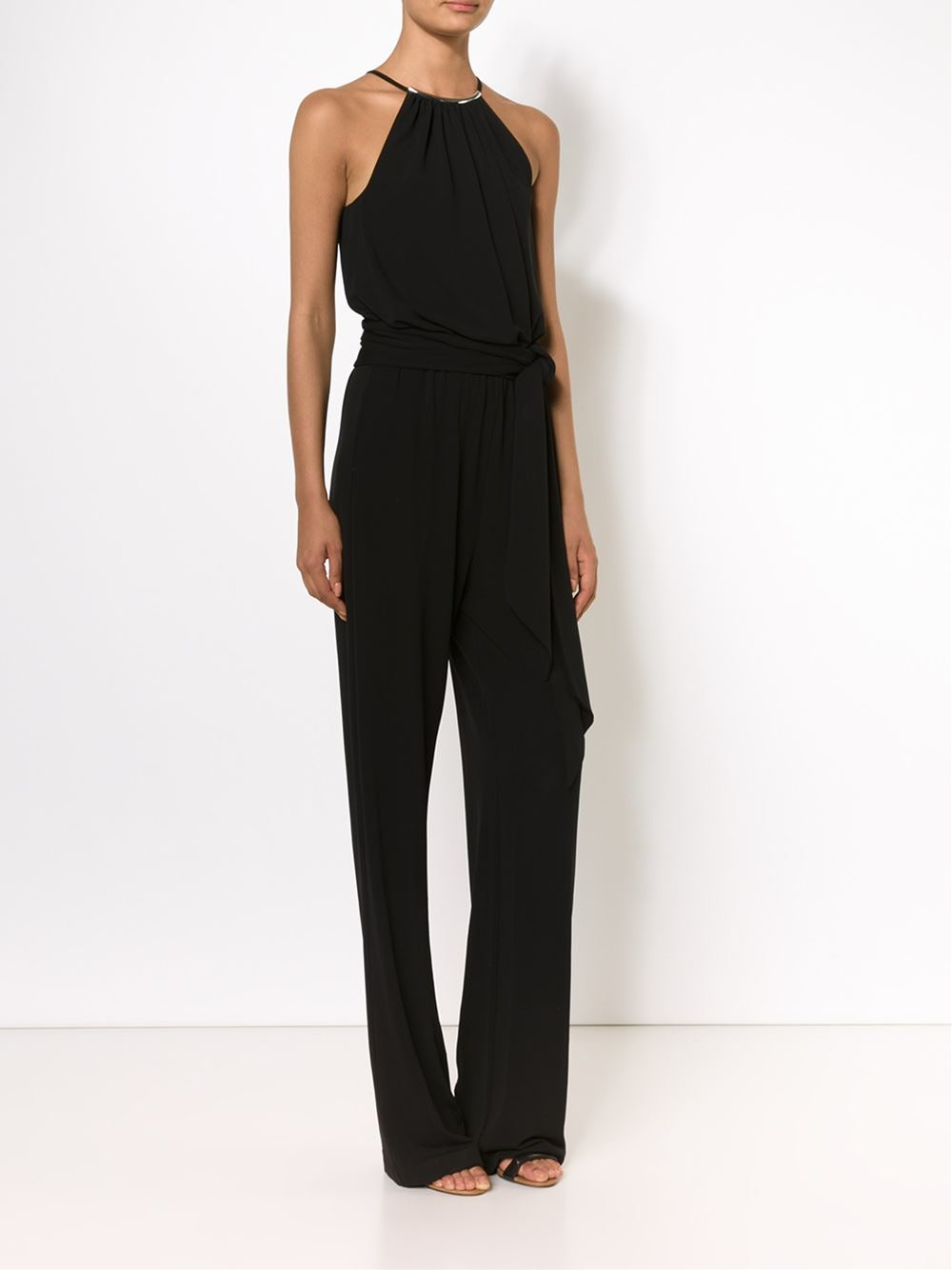 Feel good and look great in the Ponte Sleeveless Jumpsuit, a classic style that channels sophistication.