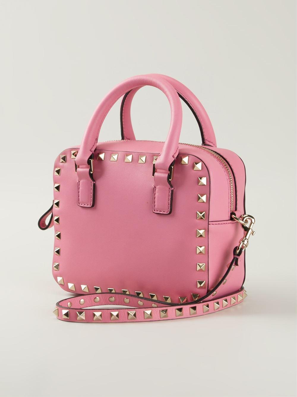 valentino rockstud crossbody bag in pink pink purple